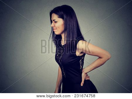 Side Profile Of A Young Stressed Woman With Backache Pain