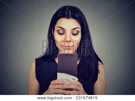 Portrait Young Woman Tired Of Diet Restrictions Craving Sweets Chocolate Isolated On Gray Wall Backg