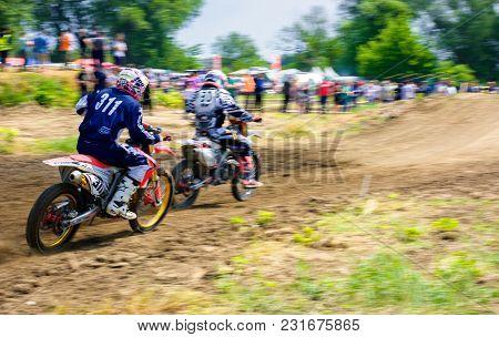 Uzhgorod, Ukraine - May 21, 2017: Mx Rider Turns On A Corner. Motion Blur With Flying Dirt. Transcar