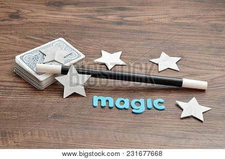 A Deck Of Cards With A Magician Wand, Stars And The Word Magic
