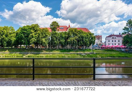 Uzhgorod, Ukraine - Jun 15, 2017: Embankment Of Uzh River In Summer. Beautiful Architecture And Blos