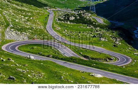 Serpentine Road In Fagarasan Mountains. Lovely Transportation Background. Popular Tourist Destinatio