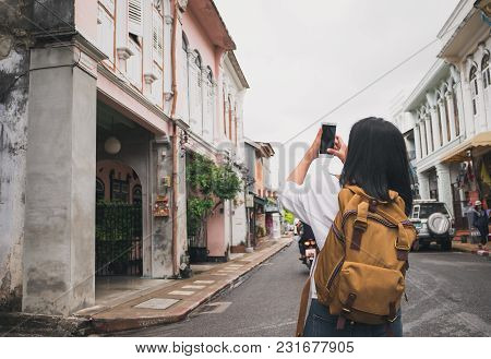 Traveler Backpacker Use Mobile Phone Taking Photo Of Old Town City While Traveling.sightseeing At Ci
