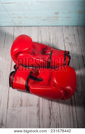 Red Boxing Gloves On Blue And White Cracked Wooden Background, Empty Space