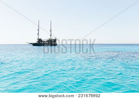 Pirate Ship On The Skyline Of Blue Sea