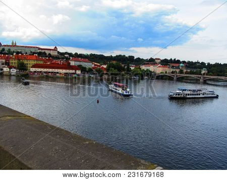 Czech Republic, Prague - August 30, 2014: Two Walking Steamers On The Vltava River Against The Backg