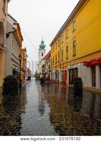 Hungary, Gyor - August 31, 2014: Kazinczy Utca (street) In Gyor On A Rainy Summer-autumn Day. A Dese