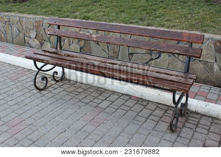 Wooden Bench In A City Park. City Furniture