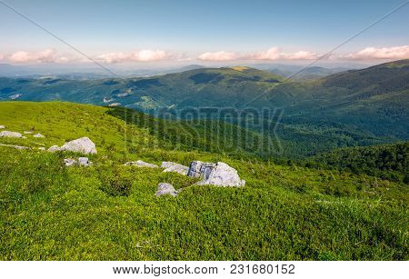 Grassy Slopes And Boulders Of Mountain Ridge In Afternoon. Beautiful Summer Scenery Of The Runa Moun