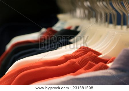 Bright Clothes Hanging On A Hanger In A Store