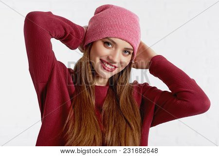 Cheerful Beautiful Model In Red Hat And Sweater With Eye Make Up And Red Lipstick Posing To Camera T