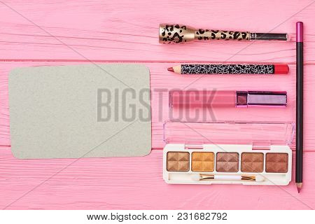 Decorative Cosmetics On Color Background. Blank Paper Card And Makeup Products. Ladies Cosmetics Kit