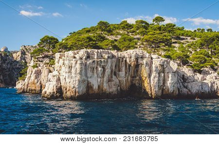 White Cliffs Of Massif Des Calanques Covered With Lush Pine Trees In Cassis Near Marseille, France