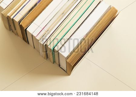 The Stack Of Books With The Shadow