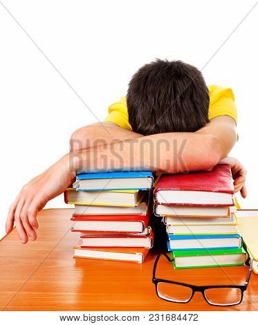 Tired Student Sleep With A Books On The White Background