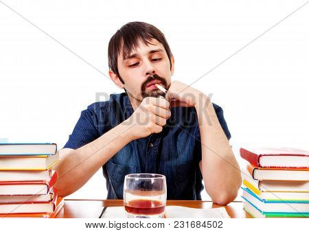 Student With Alcohol And Cigarette On The Desk Isolated On The White Background