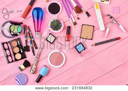 Essentials Makeup Background, Top View. Makeup Cosmetics Tools And Products, Flat Lay On Color Backg