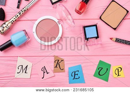Beauty Makeup Accessories, Top View. Women Blusher, Eyeshadows And Nail Polish On Color Background.
