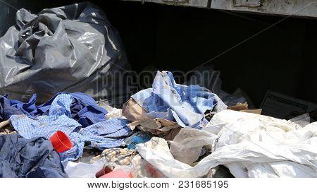 Many Rags And Waste Fabrics In The Landfill For Collecting Recyclable Material