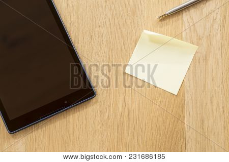 Business Concept With A Tablet And A Note