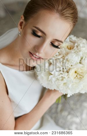 Portrait Of Beautiful And Sensual Blonde Model Girl With Closed Eyes And Professional Makeup - Bride