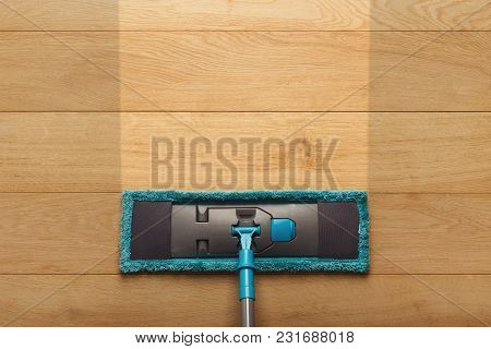 Before And After Cleaning Concept. Blue Mop On Wooden Parquet Floor Background. Cleaning Services, R