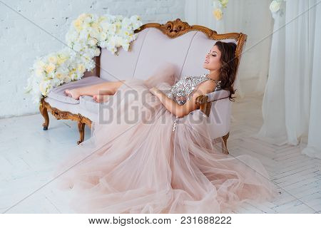 Female Beauty. Luxury Woman Portrait With Perfect Hair And Make-up. Attractive Young Lady In Elegant