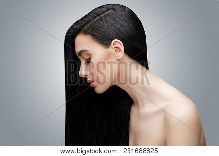 Brunette Asian Girl With Long Straight Hair. Studio Shot