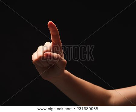 Female Hand, Forefinger Pointing On Camera Or Virtual Screen. Hand Gestures - Woman Indicating On Gl