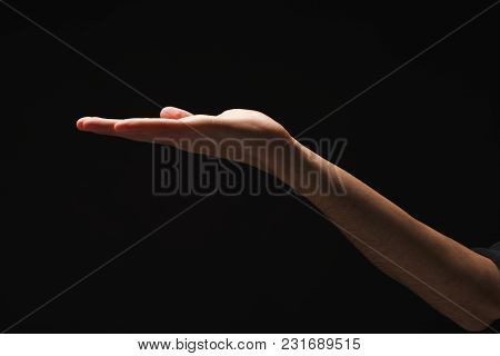Holding, Asking Or Offering. Outstretched Male Hand, Man Keeping Empty Palm On Black Isolated Backgr