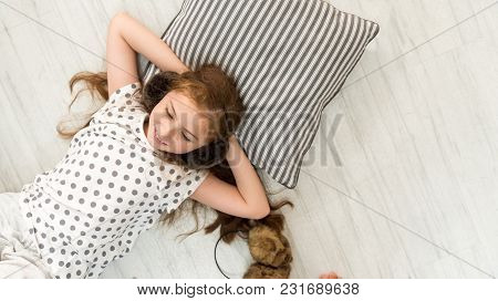 Top View Of Happiness Caucasian Girl Kid Smile Have Fun And Girls Are Lying Down To Listening The Mu