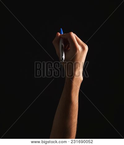 Male Hand Holding Pen, Writing Or Drawing, Isolated On Black Background. Education, Business, Art Co