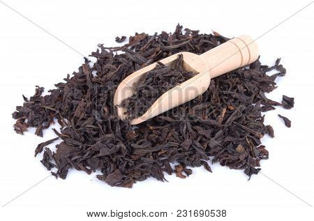 Black Tea In Wooden Scoop Isolated On White Background