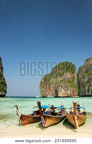 Longtail Boats Anchored At Maya Bay On Phi Phi Leh Island, Krabi Province, Thailand. It Is Part Of M