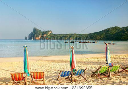 Umbrellas And Sunchairs At Ao Loh Dalum Beach On Phi Phi Don Island, Krabi Province, Thailand. Koh P