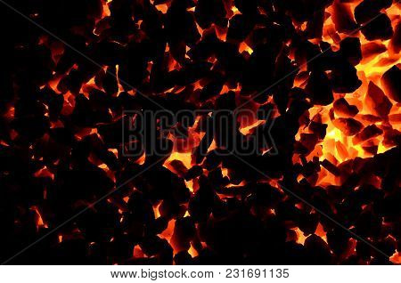 The Dark Background Of Flaming Coal Is Anthracite Fines.