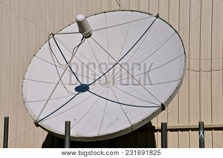 A Series Of Various Sized Television Satellite Dishes For Transmitting Signals.