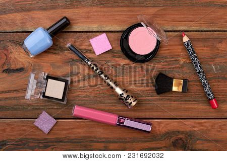 Cosmetics Products On Brown Vintage Background. Makeup Beauty Items On Woden Background. Make-up Art
