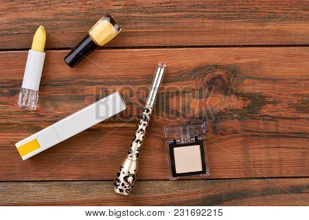 Set Of Cosmetics For Natural Makeup. Decorative Cosmetics Objects On Brown Wooden Table, Space For T