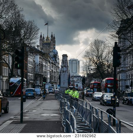 London, Uk - March 7th, 2018: Metropolitan Police Officers Stand Vigilant In Front Of 10 Downing Str