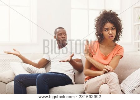 Young African-american Couple Quarreling At Home, Woman Offended. Family Relationship Difficulties C