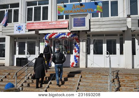 Moscow, Russia - March 18, 2018: The President Election In Russia. People Going To The Entrance Of T