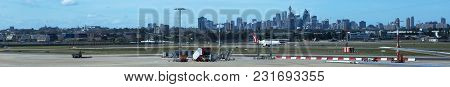 Sydney Airport, Australia - Nov 10, 2017: Aircraft Taxi On The Runway With The City Skyline As A Bac