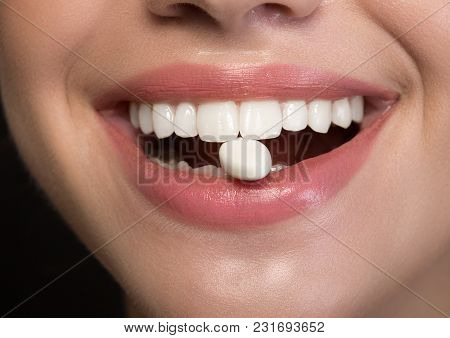 Joyful Girl Is Showing White Healthy Teeth With Chewing Gum Into Mouth. Fresh Breath Concept. Close