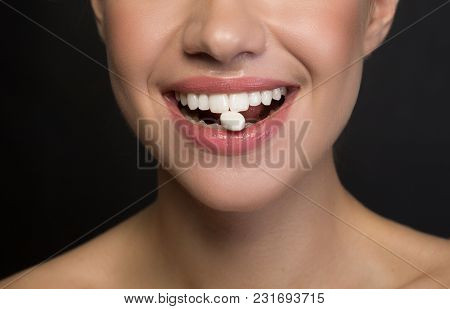 Close Up Of Mouth With White Healthy Teeth Of Positive Young Woman. She Is Enjoying Chewing Gum. Iso