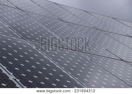 Some Solar Panels At The Top Of A Roof