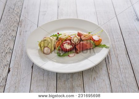 Plate Of Colored Italian Antipasti Food On A Wwooden Table