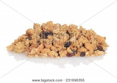 Pile Of Granola Raisin Almond Cereal On White