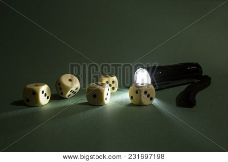 Flashlight Lights Dice As A Concept Of Luck In Gambling.