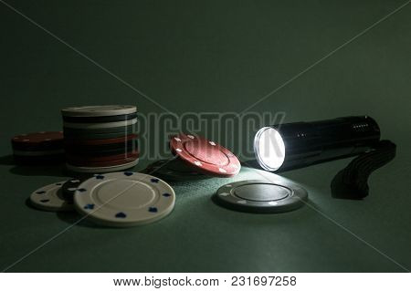 The Flashlight Lights The Playing Chips As A Concept Of Luck In Gambling.